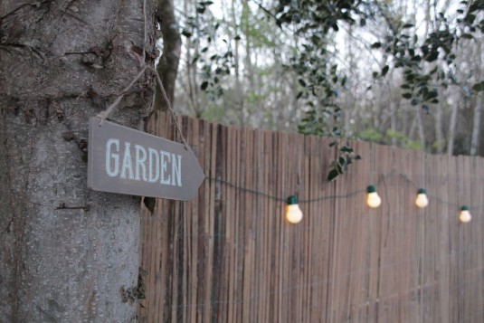 Sign and solar lights in the cottage garden