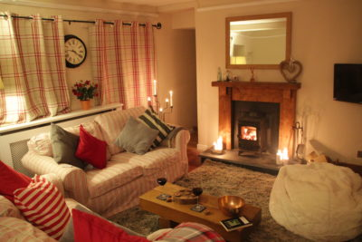 The cosy holiday cottage living room with woodburner