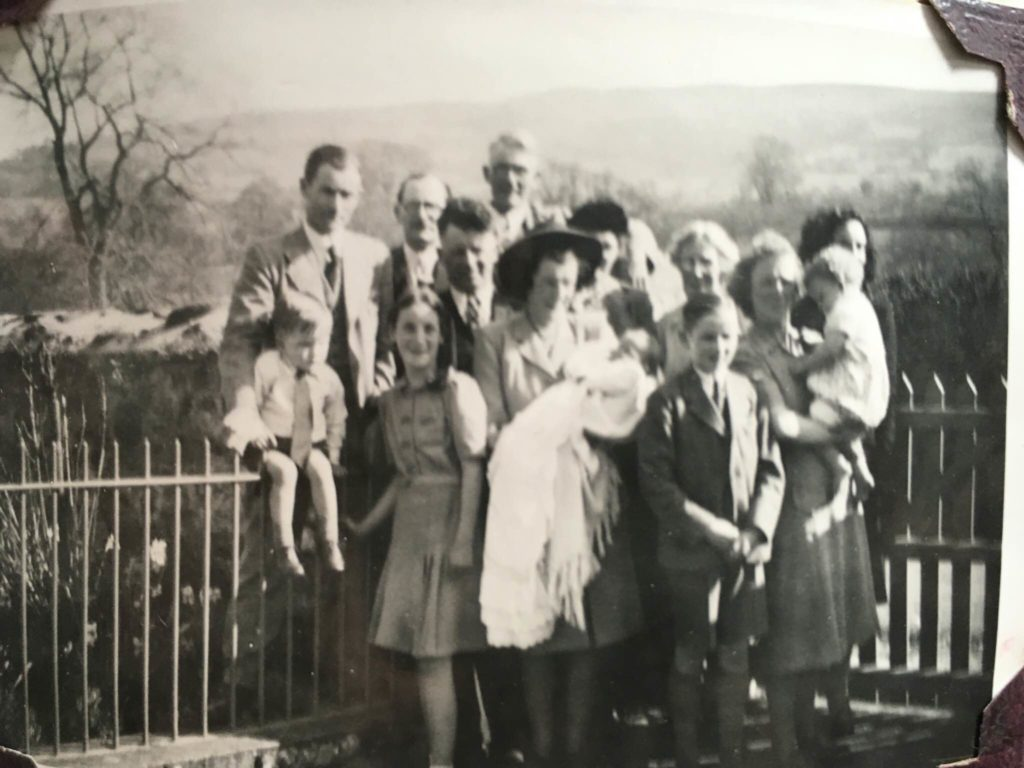 Historical family photo outside the cottage